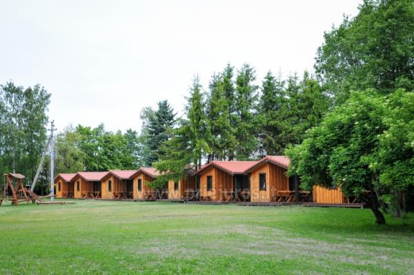 Fetingas - wooden houses and guest house on the river bank