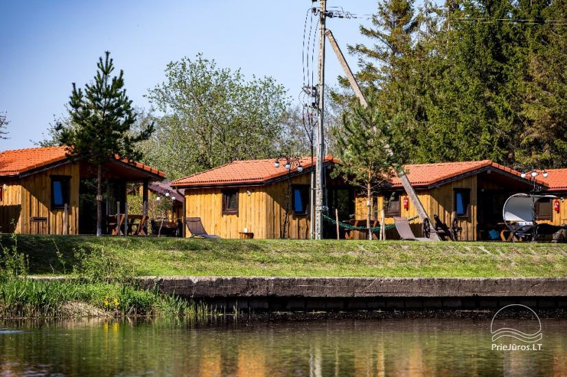 Fetingas - wooden houses and guest house on the river bank - 27