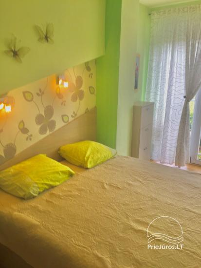 Two-bedroom Apartment Rental in Nida Saltinelis with yard, outdoor furniture - 2