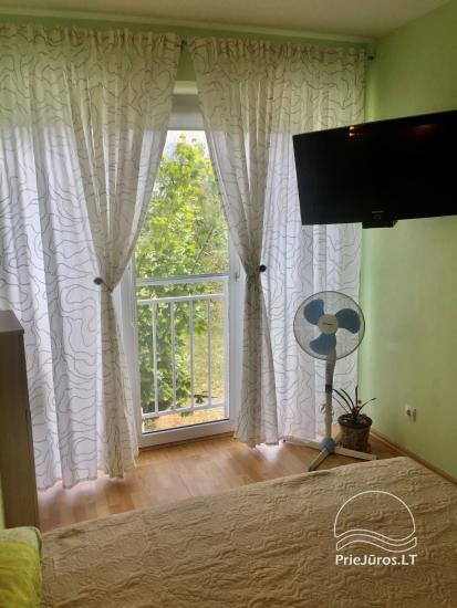 Two-bedroom Apartment Rental in Nida Saltinelis with yard, outdoor furniture - 7