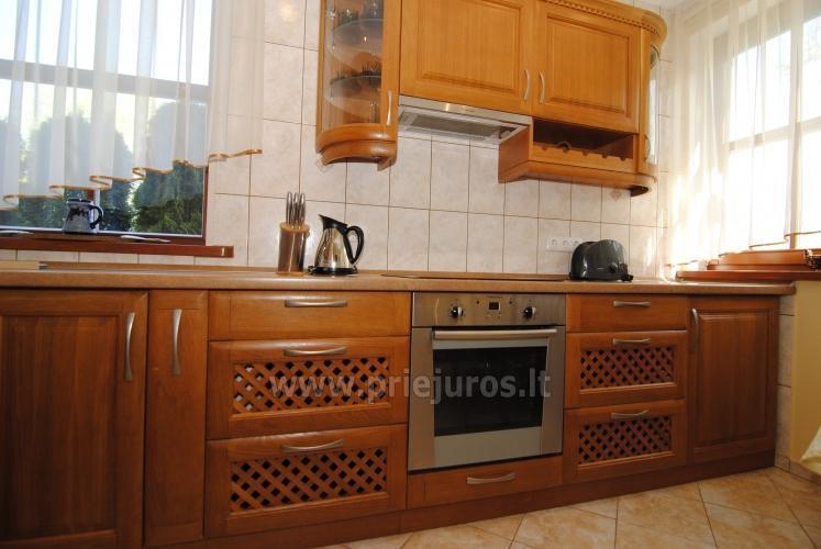 Dviejų kambarių butas Juodkrantėje su židiniu ir pavėsine kieme - 13