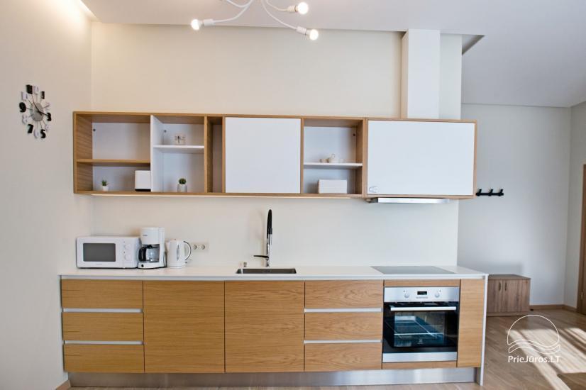 Jaukūs dviejų kambarių apartamentai nuomai Palangos širdyje - 11