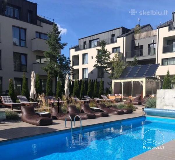 Nauji 1 ir 2 kambarių butai su šildomu baseinu nuomai Malūno vilose - 1