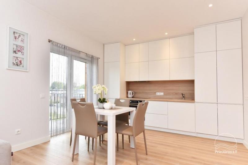 Modernūs apartamentai Kunigiškėse Jūsų patogiam poilsiui