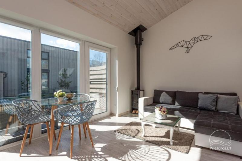 Brīvdienu māja - īrē dzīvokli ar terasi Palangā, Kunigišķos