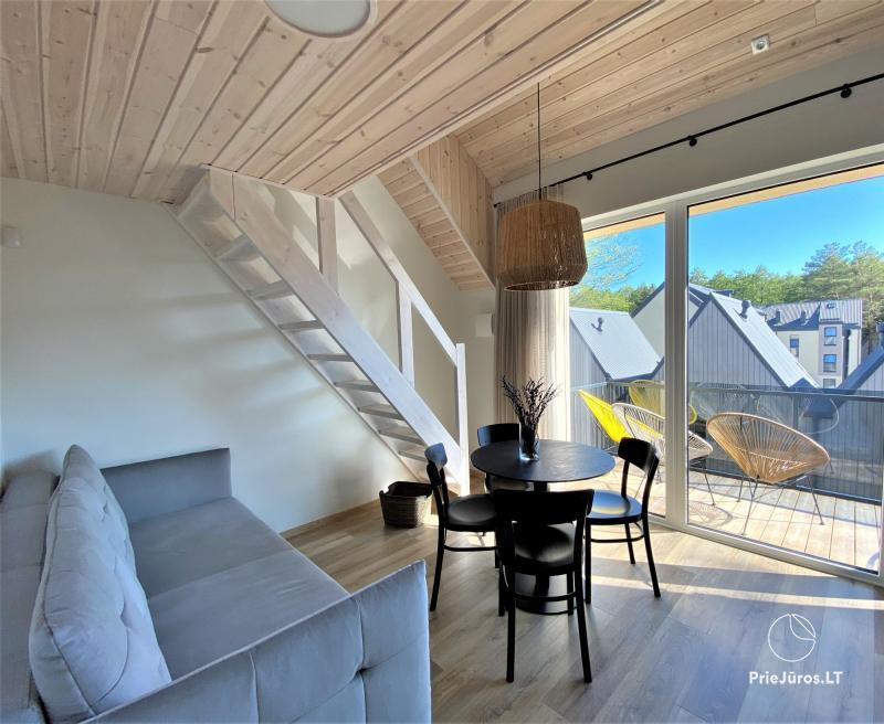 Apartamentai su terasa Jūsų poilsiui Čiki Puki kvartale su šildomu baseinu