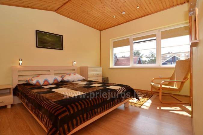 6 miegamų vietų kotedžas ir dviejų kambarių butas su terasa Nidoje