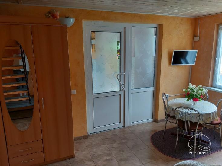 Namelis-kotedžas su terasa per 2 aukštus. 2 kambariai, 4 asmenims - 9