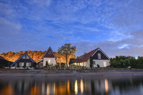 Separate holiday cottages and apartments on the shore of the lagoon