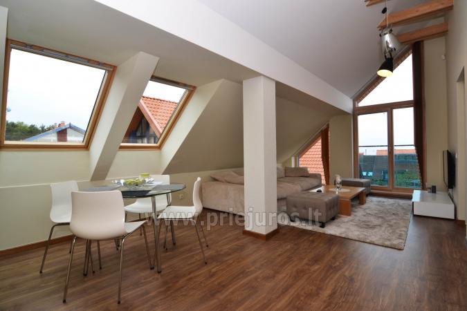 Puikiai įrengti dviejų kambarių apartamentai Nidoje su vaizdu į marias