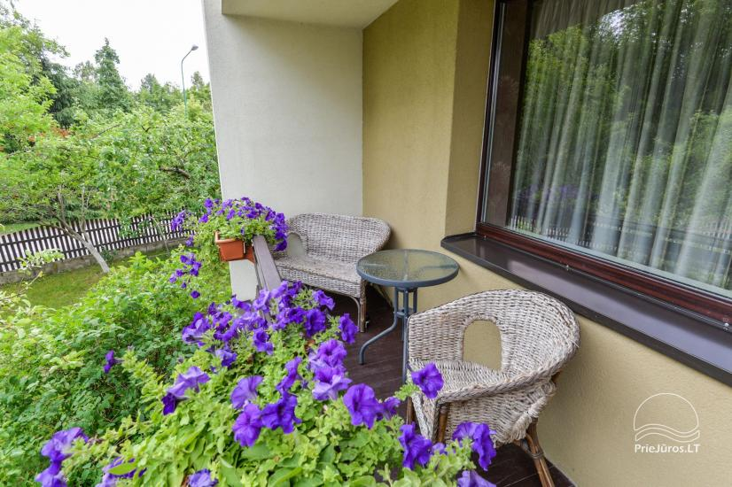 Accommodation in Palanga villa VAKARE. In the yard: summerhouses with outdoor furniture, playground for kids - 22