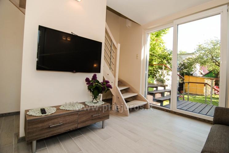 Jaukus skandinaviško stiliaus namas poilsiui Palangos centre.