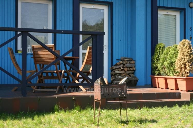 Cottage with three separate bedrooms in Pervalka