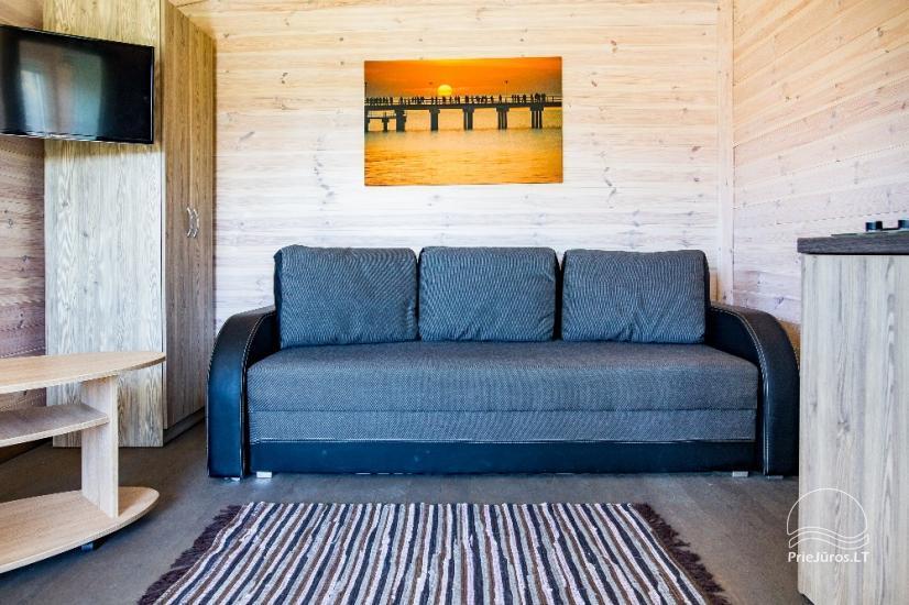 Jaunas vienu i divu istabu koka mājas Sventoji - 30