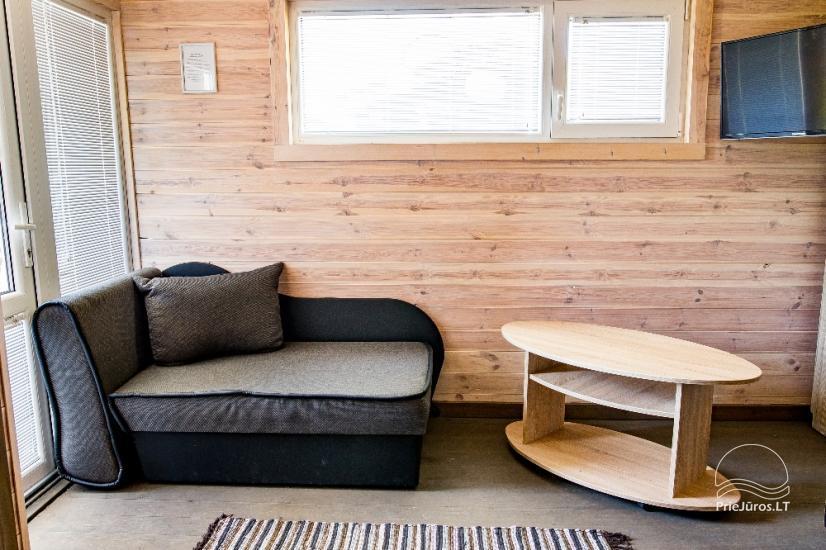 Jaunas vienu i divu istabu koka mājas Sventoji - 31