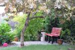 Private villa's yard with a garden, large pergola, children's playground, car parking lot - 14